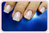 Woman showing her acrylic nail extensions image