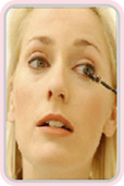 Woman tinting her eye lashes image