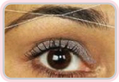 Woman having threading treatment on her eye brows image